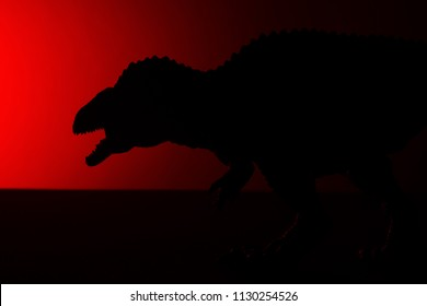 acrocanthosaurus shadow with red light in dark