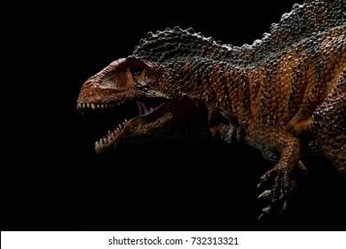 acrocanthosaurus toy on a black background