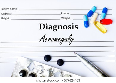 Acromegaly  - Diagnosis written on a piece of white paper with medication and Pills
