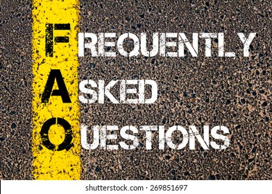 Acronym FAQ - Frequently Asked Questions. Business Conceptual image with yellow paint line on the road over asphalt stone background.