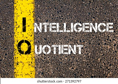 Acronym IQ as Intelligence Quotient. Yellow paint line on the road against asphalt background. Conceptual image