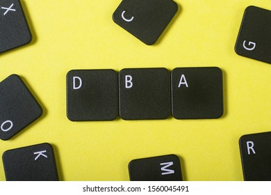 Acronym from keyboard buttons with letters. DBA Yellow background.