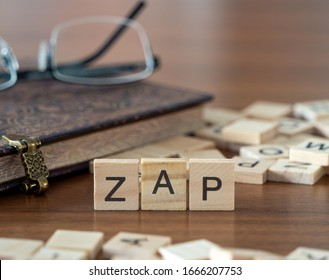 the acronym zap for Zed Attack Proxy concept represented by wooden letter tiles on a wooden table with glasses and a book - Shutterstock ID 1666207753