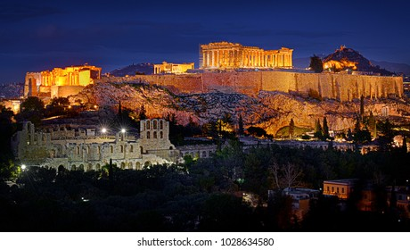 The Acropolis of Athens in Greece lit by artificial light against a twilight deep blue sky