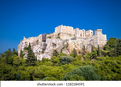 Acropolis of Athens, Greece. It is the main landmark of Athens. Scenic panorama of Acropolis hill with ancient Greek ruins in Athens center. Famous historical architecture of Athens in summer.
