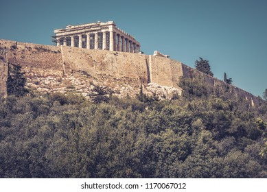Acropolis of Athens, Greece. It is the main tourist attraction of Athens. Scenic view of Acropolis with the famous Parthenon. Ancient Greek ruins in the Athens center in summer. The vintage photo.