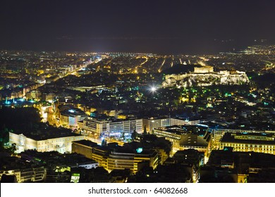 Acropolis and Athens in Greece at night - travel background