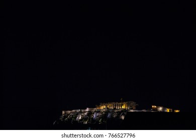 Acropolis in Athens, Greece, taken from the bottom of its hill, during a dark evening. Legacy from the Ancient Greece, it is the most iconic Greek landmark