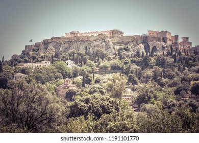 Acropolis hill, Athens, Greece. Scenic panorama of the ancient Greek Agora overlooking famous Acropolis. Landscape of the antique Athens center in summer. This place is the main landmark of Athens.