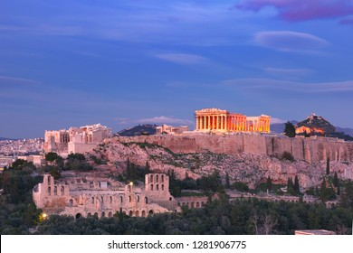 Acropolis Hill, crowned with Parthenon during evening blue hour in Athens, Greece