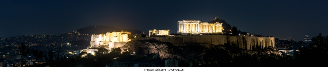 Acropolis hill at night, Athens, Greece. It is a top landmark of Athens. View of Ancient Greek ruins in the Athens center in evening. Panorama of the Athens city with illuminated Parthenon temple.