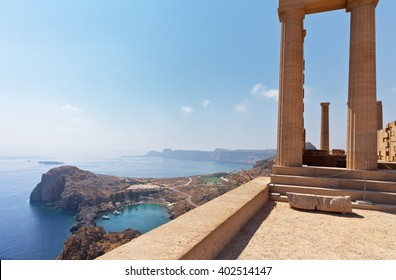 Acropolis of Lindos. Doric columns of the ancient Temple of Athena Lindia the IV century BC and the bay of St. Paul. Greece. Rhodes