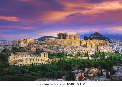 Acropolis with Parthenon, the theater of Herodion Atticus under the ruins of Acropolis and cityscape of Athens, Greece.
