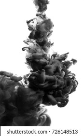 Acrylic black and white paint and ink in water. Abstract background. Isolated on white. smoke