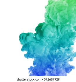Acrylic colors and ink in water. Ink swirling in water. Ink in water isolated on white background. Colorful ink in water. Paint splash. Blue Green Colorful Abstract background