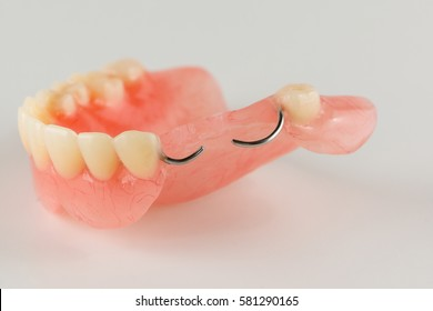 acrylic denture with metal clasps for restoring dentition