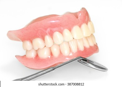 Acrylic dentures whit mirror on white background