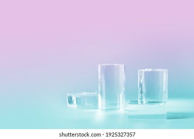 Acrylic empty podium for product presentation on nein pink and blue colored background, transparent geometric pedestals