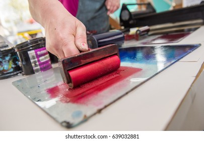an acrylic paint roller for mono printing and screen printing, rolling paint ready for mono printing.