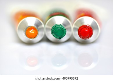 Acrylic paint tubes on white background. Traffic lights - Concept.