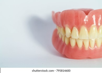 Acrylic removable prosthesis of dentist on a white background.