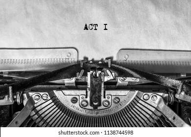 ACT I, typed text on a vintage typewriter, screenplay title heading. On old