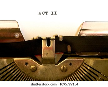 ACT II, screenplay manuscript heading title typed in black ink on white paper on vintage manual typewriter