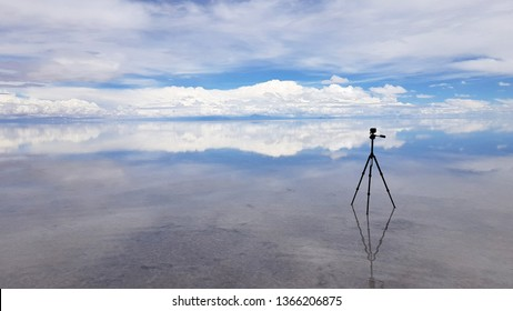 An action cam in the Salar de Uyuni flooded after the rains, Bolivia. Clouds reflected in the water of the Salar de Uyuni, Bolivia