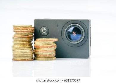 Action camera and coins with financial conceptual.
