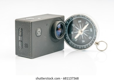 Action camera and compass with travel concept.