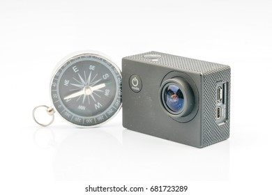 Action camera and compass with travell concept.