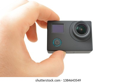 the action the camera is held in a hand on a white background