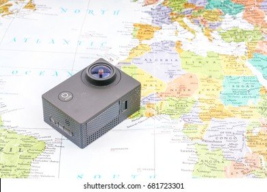 Action camera with map background. Travel and planning concept.