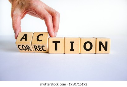 Action or correction symbol. Businessman turns wooden cubes and changes the word correction to action. Beautiful white background, copy space. Business and action or correction concept.
