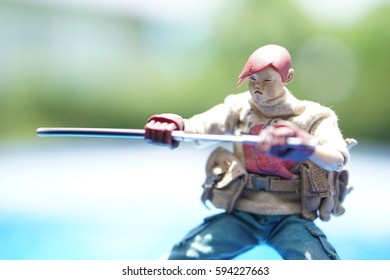 action figure with katana sword