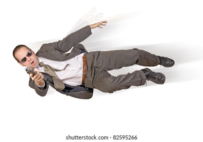 Action hero. Agent with gun flying jump. Businessman jumps with a gun on a white background. A man in a business suit in a action position shooting of pistol. Police officer with a gun action
