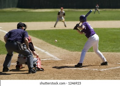 Action at a high school baseball game on a sunny day in Maine