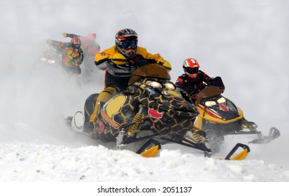 action from kirkland lake snowmobile races