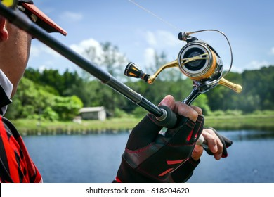 action of lure angler casting with spinning reel in fishing tournament