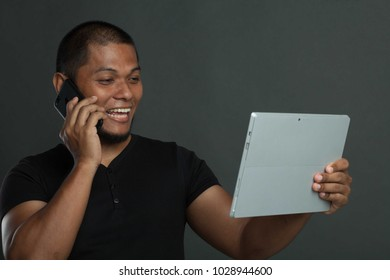 action man using tablet and talking on his phone