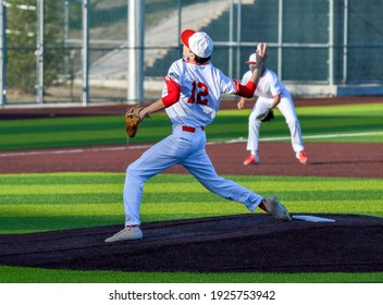 Action photo of high school baseball players making plays during a baseball game