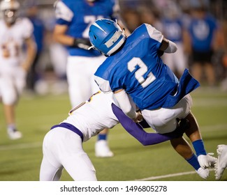 Action photos of high school football players making amazing plays during a football game