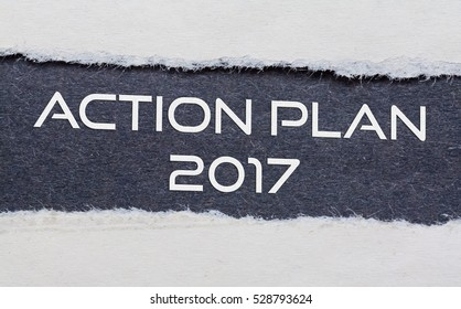action plan 2017 words under torn black paper.