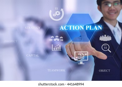 ACTION  PLAN  concept presented by  businessman touching on  virtual  screen
