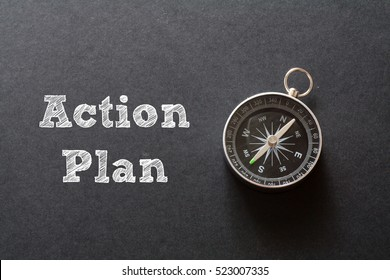 Action Plan written with Compass on black paper background