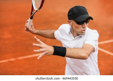 Action portrait of professional tennis player