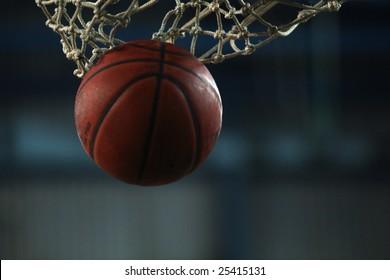 Action shot of basketball going through basketball hoop