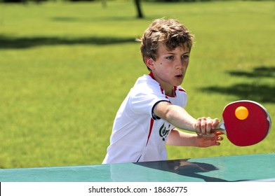 action shot of boy playing table tennis