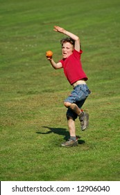 action shot of boy throwing ball