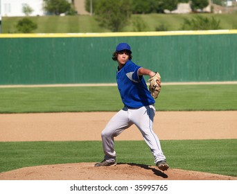 action shot of a high school baseball pitcher on the pitcher's mound